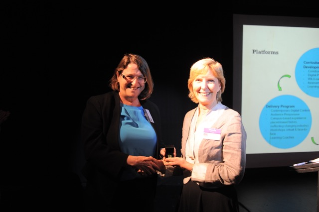 Dr Wendy Green receives her fellowship pin from Professor Sally Gift